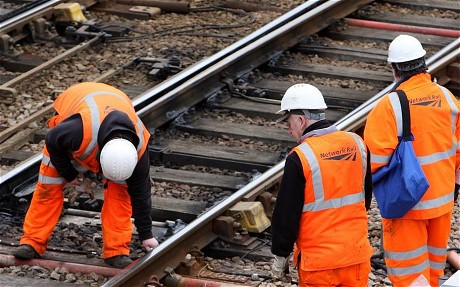 Network Rail in legal bid to halt signallers' strike...Network Rail engineers work on the track near to Cambridge City train station in the centre of the city.PRESS ASSOCIATION Photo. Picture date: Thursday April 1, 2010. Network Rail urged a High Court judge to grant an injunction today to block a strike which it says would cause 'immense damage to the economy'. See PA story COURTS Rail. Photo credit should read: Chris Radburn/PA Wire